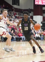 Washington guard Elijah Hardy (10) drives the ball past Stanford guard Isaac White (4) during the first half of an NCAA college basketball game Thursday, Jan. 9, 2020, in Stanford, Calif. (AP Photo/Tony Avelar)
