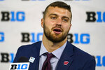 FILE - In this July 23, 2021, file photo, Wisconsin tight end Jake Ferguson talks to reporters during an news conference at the Big Ten Conference NCAA college football media days at Lucas Oil Stadium in Indianapolis. Ferguson has a special understanding of his school's football history that makes him want to leave his own legacy on the program. Growing up as the grandson of former Wisconsin football coach and athletic director Barry Alvarez will do that. (AP Photo/Michael Conroy, File)