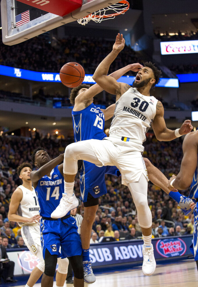 Marquette forward Ed Morrow, center, gets a slam dunk against Creighton during the first half of an NCAA college basketball game Sunday, March 3, 2019, in Milwaukee. (AP Photo/Darren Hauck)