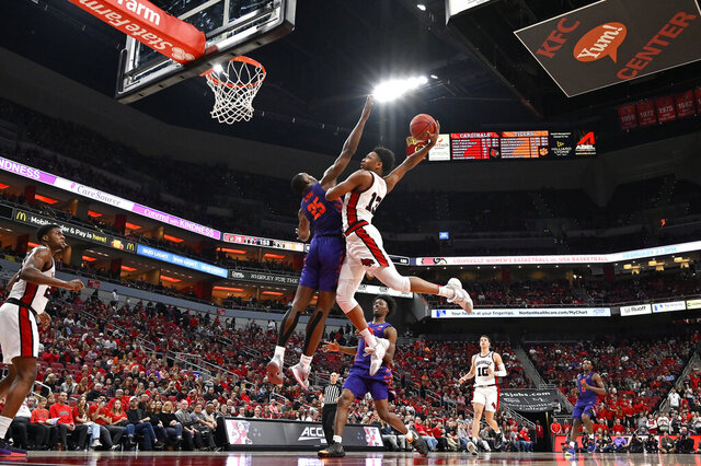 Louisville guard David Johnson (13) attempts to dunk over Clemson forward Aamir Simms (25) during the second half of an NCAA college basketball game in Louisville, Ky., Saturday, Jan. 25, 2020.  (AP Photo/Timothy D. Easley)