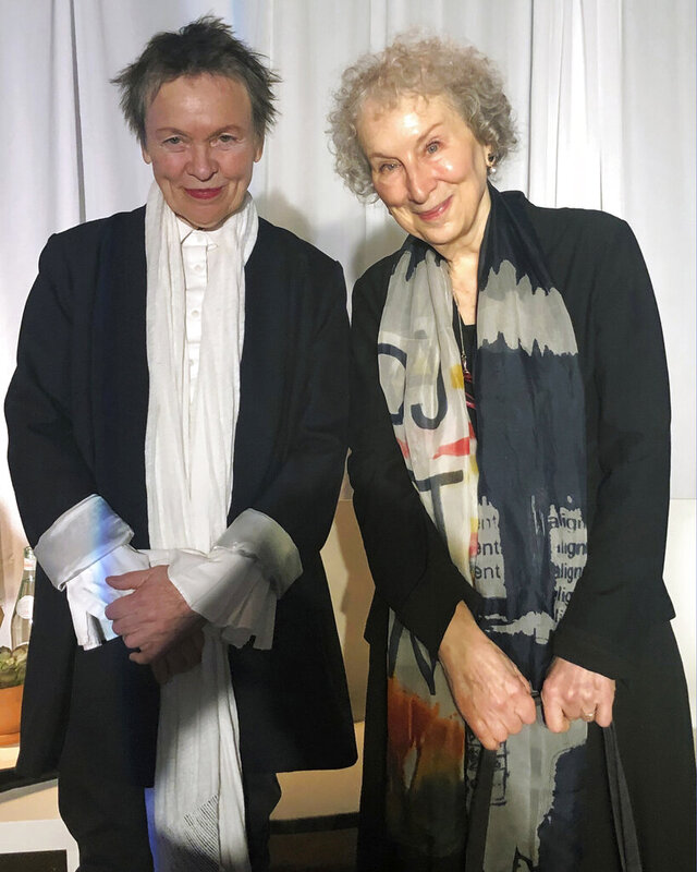 American avant-garde artist, composer, musician and film director Laurie Anderson, left, and Canadian author Margaret Atwood pose for photographs before speaking together at an event sponsored by the MacDowell Colony, Monday, Dec. 9, 2019, in New York. (AP Photo/Hillel Italie)