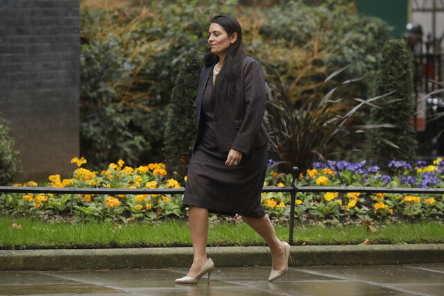 FILE - In this file photo dated Thursday, Feb. 13, 2020, British Lawmaker Priti Patel, the Home Secretary arrives at 10 Downing Street in London.  An investigation has reportedly found that Home Secretary Priti Patel broke ministerial rules by bullying staff, as a summary of its findings is expected to be released Friday Nov. 20, 2020.  Patel denies the allegations. (AP Photo/Matt Dunham, FILE)