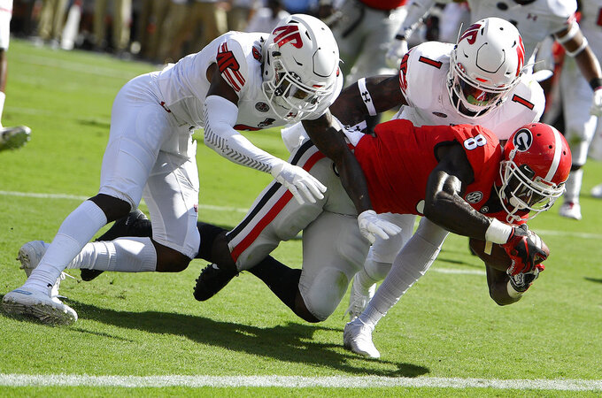 Georgia running back James Cook (6) scores a touchdown against Austin Peay defensive back Malik Davis (1) during the first half of an NCAA college football game, Saturday, Sept. 1, 2018, in Athens, Ga. (AP Photo/Mike Stewart)