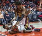 Illinois forward Kipper Nichols grabs a loose ball next to Minnesota center Daniel Oturu (25) during the second half of an NCAA college basketball game in Champaign, Ill., Wednesday, Jan. 16, 2019. (AP Photo/Rick Danzl)