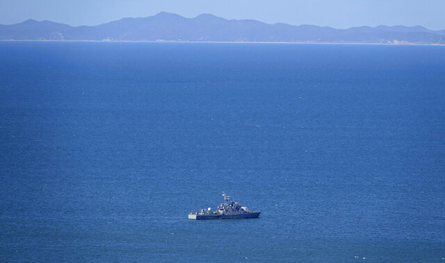 A South Korean navy ship is seen near Yeonpyeong island, South Korea, Friday, Sept. 25, 2020. South Korea said Thursday North Korean troops shot a South Korean government official who may have attempted to defect and set his body on fire, after they found him on a floating object in waters near the rivals' disputed sea boundary. (Baek Seung-ryul/Yonhap via AP)