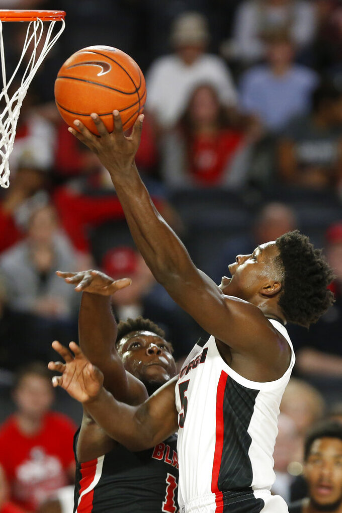 Georgia's Anthony Edwards (5) shoots over Valdosta State's Darrell Jones during an NCAA college exhibition basketball game in Athens, Ga., Friday, Oct. 18, 2019. (Joshua L. Jones/Athens Banner-Herald via AP)