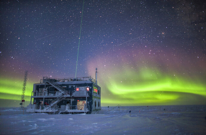 This undated photo provided by NOAA in May 2018 shows aurora australis near the South Pole Atmospheric Research Observatory in Antarctica. When a hole in the ozone formed over Antarctica, countries around the world in 1987 agreed to phase out several types of ozone-depleting chemicals called chlorofluorocarbons (CFCs). Production was banned, emissions fell and the hole shriveled. But according to a study released on Wednesday, May 16, 2018, scientists say since 2013, there's more of a banned CFC going into the atmosphere. (Patrick Cullis/NOAA via AP)