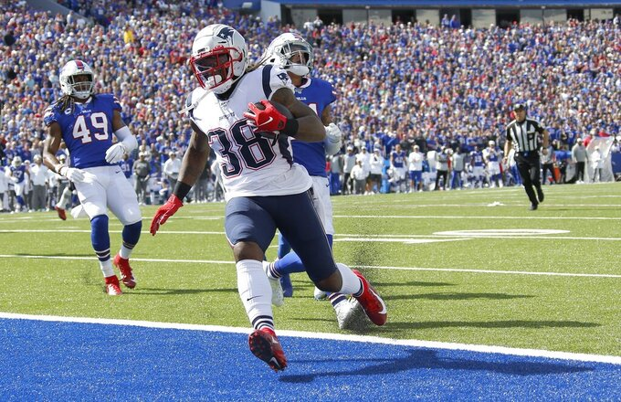 New England Patriots running back Brandon Bolden runs for a touchdown against the Buffalo Bills in the first half of an NFL football game, Sunday, Sept. 29, 2019, in Orchard Park, N.Y. (AP Photo/Ron Schwane)