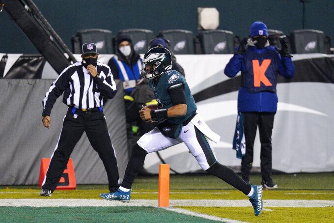 Philadelphia Eagles' Jalen Hurts scores a touchdown during the first half of an NFL football game against the Washington Football Team, Sunday, Jan. 3, 2021, in Philadelphia. (AP Photo/Chris Szagola)