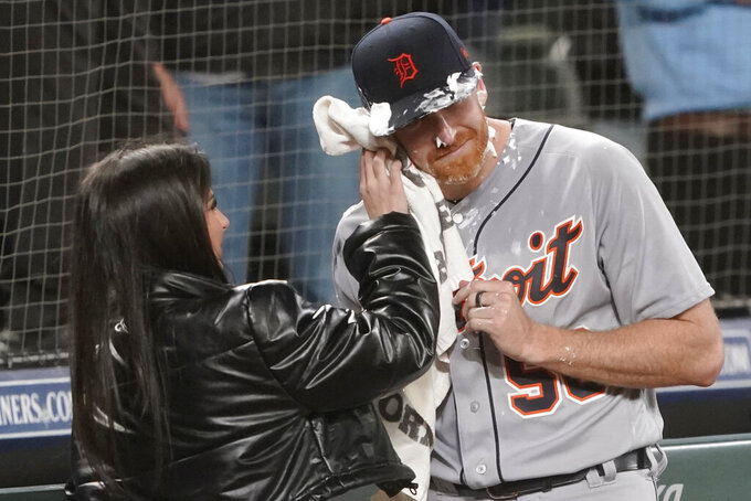 Detroit Tigers starting pitcher Spencer Turnbull (56) has shaving cream wiped from his face by an unidentified woman after he threw a no-hitter in the team's baseball game against the Seattle Mariners, Tuesday, May 18, 2021, in Seattle. The Tigers won 5-0. (AP Photo/Ted S. Warren)