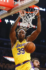 Los Angeles Lakers' Dwight Howard dunks against the Oklahoma City Thunder during the first half of an NBA basketball game Tuesday, Nov. 19, 2019, in Los Angeles. (AP Photo/Ringo H.W. Chiu)