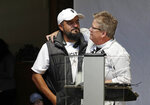 Jose Robles, left, is embraced by Gethsemane Lutheran Church Pastor Joanne Engquist inside Riverton Park United Methodist Church before Robles left to present himself to U.S. Immigration and Customs Enforcement officials Wednesday, July 17, 2019, in Tukwila, Wash. Robles, who has spent the past year inside a Seattle church to avoid being deported to Mexico, has been detained. The arrest Wednesday prompted protests from a crowd of supporters who had accompanied Robles to the agency. His deportation has temporarily been put on hold by a federal appeals court, and he has a pending visa application. (AP Photo/Elaine Thompson)