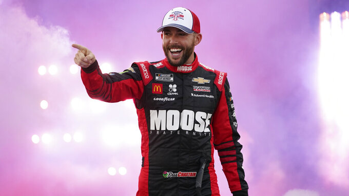 Ross Chastain waves to the crowd during driver introductions prior to the start of the NASCAR Cup series auto race in Richmond, Va., Saturday, Sept. 11, 2021. (AP Photo/Steve Helber)