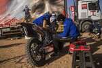In this Monday, Jan. 13, 2020 photo, Sara Garcia of Spain checks her Yamaha motorbike, next to his partner Javier Vega of Spain at the Dakar rally