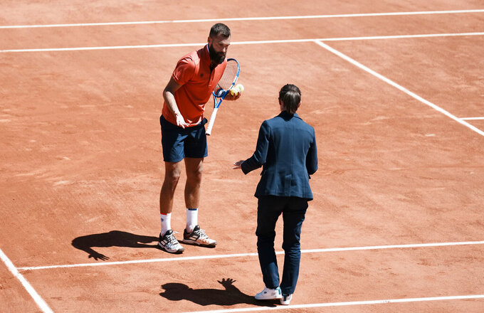 Benoit Paire of France challenges a line call with the umpire as he plays against Norway's Casper Ruud during their first round match on day two of the French Open tennis tournament at Roland Garros in Paris, France, Monday, May 31, 2021. (AP Photo/Thibault Camus)