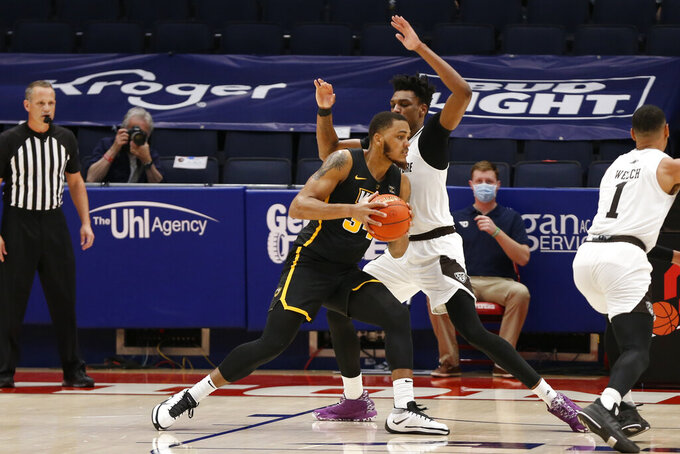 VCU's Levi Stockard, left, posts up against St. Bonaventure's Osun Osunniyi during the first half of an NCAA college basketball championship game for the Atlantic Ten Conference tournament Sunday, March 14, 2021, in Dayton, Ohio. (AP Photo/Jay LaPrete)