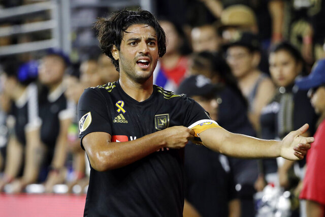 FILE - In this Saturday, Sept. 21, 2019, file photo, Los Angeles FC's Carlos Vela is shown during the second half of an MLS soccer match against Toronto FC, in Los Angeles. Major League Soccer MVP Carlos Vela will not accompany Los Angeles FC to the league's return tournament in Orlando this month. Vela announced his decision Monday, July 6, 2020, citing his concern for the health of his family, including his pregnant wife.(AP Photo/Marcio Jose Sanchez, File)