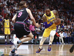 Los Angeles Lakers forward LeBron James drives against Miami Heat forward Kelly Olynyk during the first half of an NBA basketball game Sunday, Nov. 18, 2018, in Miami. (AP Photo/Brynn Anderson)