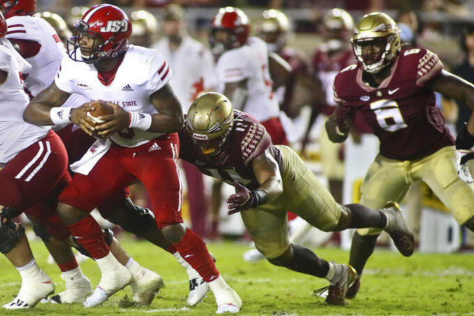 Jacksonville State quarterback Zerrick Cooper (6) is sacked by Florida State defensive end Jermaine Johnson II (11) in the second quarter of an NCAA college football game Saturday, Sept. 11, 2021, in Tallahassee, Fla. (AP Photo/Phil Sears)