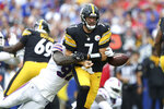 Buffalo Bills defensive end Mario Addison (97) strips the ball from Pittsburgh Steelers quarterback Ben Roethlisberger (7) during the first half of an NFL football game in Orchard Park, N.Y., Sunday, Sept. 12, 2021. The Bills recovered the ball. (AP Photo/Joshua Bessex)