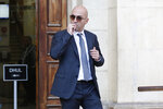 Maltese businessman Yorgen Fenech, who was taken into custody by police last week as he was trying to flee the island, leaves court after being questioned in the 2017 bomb blast that killed investigative journalist Daphne Caruana Galizia as she drove near her home, in Valletta, Malta, Friday, Nov. 29. 2019. (AP Photo/str)