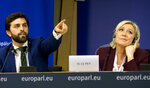 French far-right National Rally leader and MEP Marine Le Pen, right, and Italy's Lega party member and MEP Marco Zanni attend a media conference to announce the formation of a new far-right European Parliament group at the European Parliament in Brussels, Thursday, June 13, 2019. (AP Photo/Virginia Mayo)