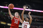 Nebraska's Charlie Easley (30) puts up a shot against Indiana's Jerome Hunter (21) during the second half of an NCAA college basketball game at the Big Ten Conference tournament, Wednesday, March 11, 2020, in Indianapolis. Indiana won 89-64. (AP Photo/Darron Cummings)