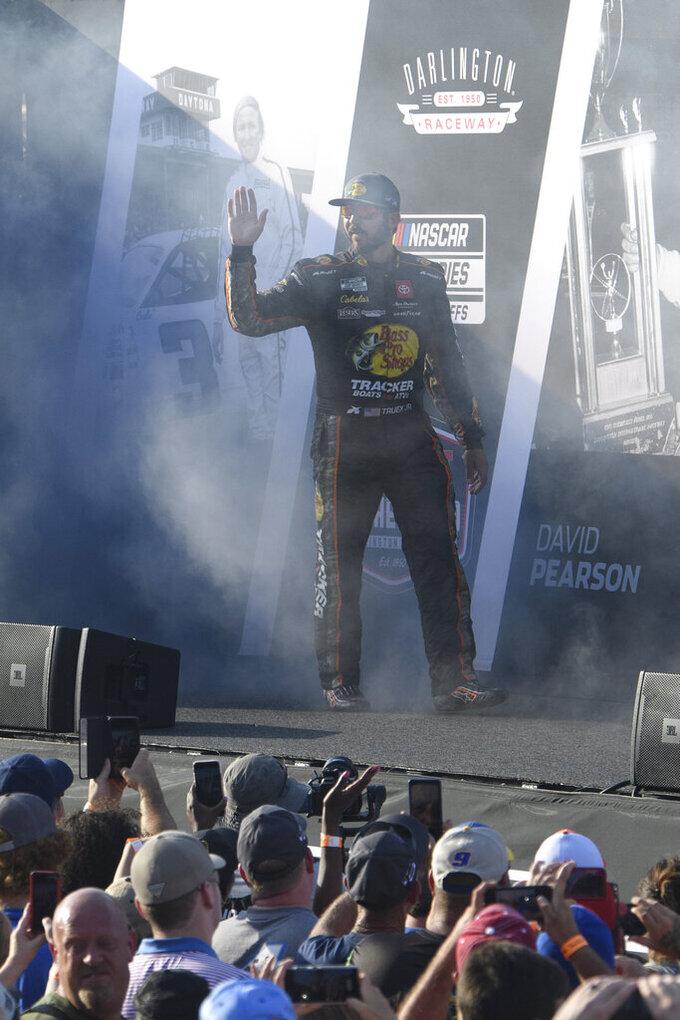 Martin Truex Jr. is introduced before a NASCAR Cup Series auto race Sunday, Sept. 5, 2021, in Darlington, S.C. (AP Photo/John Amis)