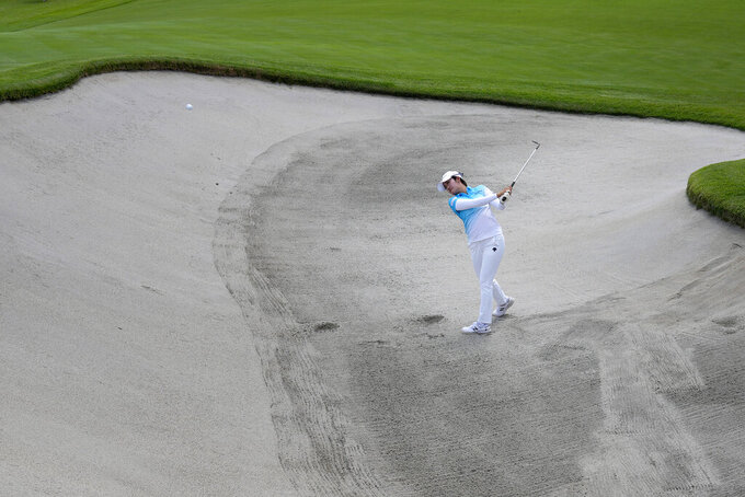 Mone Inami, of Japan, hits from the ninth green bunker during a practice round prior to the women's golf event at the 2020 Summer Olympics, Monday, Aug. 2, 2021, at the Kasumigaseki Country Club in Kawagoe, Japan, (AP Photo/Andy Wong)