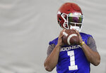 Oklahoma quarterback Kyler Murray sets back to pass during an NCAA college football practice Thursday, Dec. 27, 2018, in Davie, Fla. Oklahoma plays Alabama in the Orange Bowl on Dec. 29. (AP Photo/Brynn Anderson)