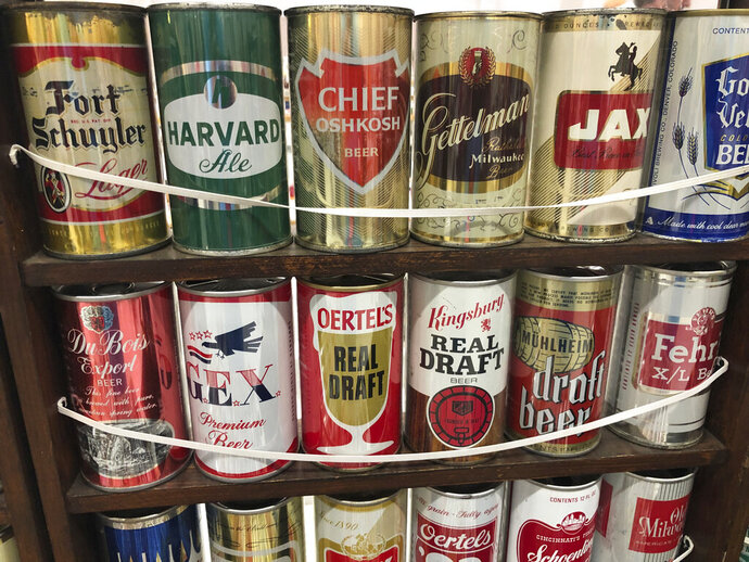 Vintage mid-century beer cans are on display Thursday, Aug. 29, 2019, in Albuquerque, N.M., at the 49th annual gathering of members of the Brewery Collectibles Club of America. Collectors from around the world began Thursday buying, trading and selling containers of brews at the annual four-day event billed the