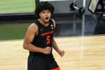 Oregon State's Ethan Thompson (5) celebrates after making a 3-point shot against Oregon during the first half of an NCAA college basketball game in the semifinal round of the Pac-12 men's tournament Friday, March 12, 2021, in Las Vegas. (AP Photo/John Locher)