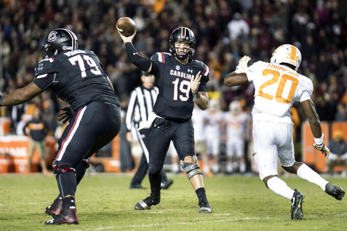 South Carolina quarterback Jake Bentley (19) throws a pass against Tennessee defensive back Bryce Thompson (20) during the second half of an NCAA college football game Saturday, Oct. 27, 2018, in Columbia, S.C. (AP Photo/Sean Rayford)