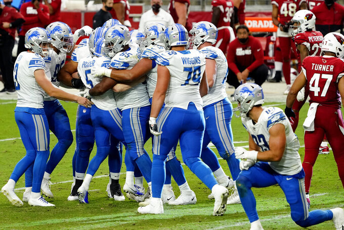 Detroit Lions kicker Matt Prater (5) celebrates after kicking the game winning field goal with his teammates during the second half of an NFL football game against the Arizona Cardinals, Sunday, Sept. 27, 2020, in Glendale, Ariz. The Lions won 26-23. (AP Photo/Rick Scuteri)