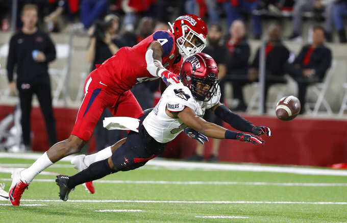 UNLV wide receiver Steve Jenkins tries to haul in a long pass as Fresno State defensive back Wylan Free covers during the first half of an NCAA college football game in Fresno, Calif., Friday, Oct. 18, 2019. (AP Photo/Gary Kazanjian)