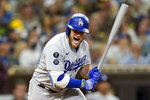 Los Angeles Dodgers' Max Muncy reacts to flying out during the third inning of the team's baseball game against the San Diego Padres, Tuesday, Aug. 24, 2021, in San Diego. (AP Photo/Gregory Bull)