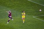 United States' Megan Rapinoe, left, scores her side's second goal against Australia during the women's bronze medal soccer match at the 2020 Summer Olympics, Thursday, Aug. 5, 2021, in Kashima, Japan. (AP Photo/Kiichiro Sato)