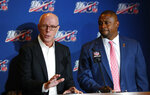 Atlanta Falcons president and CEO Rich McKay, left, a member of the NFL competition committee, speaks as NFL executive vice president Troy Vincent, right, looks on during a news conference at the NFL Fall League Meeting, Tuesday, Oct. 15, 2019 in Fort Lauderdale, Fla. NFL owners begin two days of meetings Tuesday with formal bargaining talks on a new collective bargaining agreement expected to resume soon. (AP Photo/Wilfredo Lee)