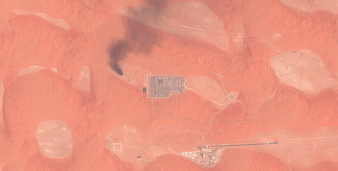 This Saturday, Aug. 17, 2019 false-color image from the European Commission's Sentinel-2 satellite that was processed by Sinergise's Sentinel Hub website shows smoke rising from a natural gas facility at the Shaybah oil field in Saudi Arabia after a drone attack claimed by Yemen's Houthi rebels. Drones launched by the Houthis attacked a massive oil and gas field deep inside Saudi Arabia's sprawling desert on Saturday, causing what the kingdom described as a