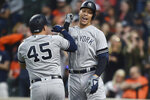 New York Yankees Aaron Judge, right, celebrates his solo home run against the Baltimore Orioles with Luke Voit, in the first inning of a baseball game Saturday, April 6, 2019, in Baltimore. (AP Photo/Gail Burton)