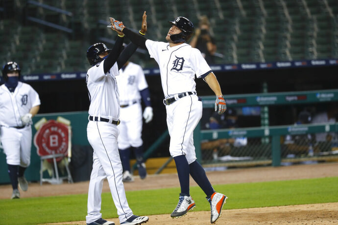 Detroit Tigers' JaCoby Jones celebrates his two-run inside-the-park home run in the seventh inning of a baseball game against the Chicago White Sox in Detroit, Monday, Aug. 10, 2020. (AP Photo/Paul Sancya)