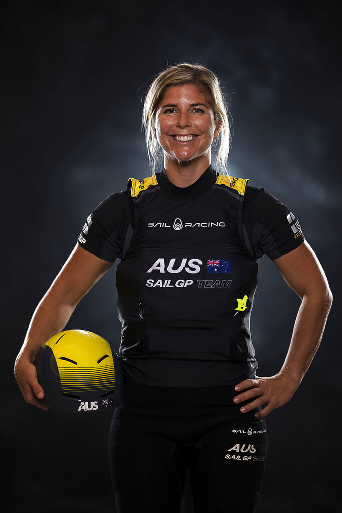 In this photo provided by SailGP, date not known, Nina Curtis poses for a portrait in Hamilton, Bermuda. Curtis has been picked to join the defending champion Australian SailGP team for the rest of the season as part of a developmental program designed to bring women into the global league. Curtis, who won a silver medal at the 2012 London Olympics and sailed with Team Brunel on the final five legs of the 2017-18 Volvo Ocean Race, beat out Lisa Darmanin in a training camp during the season-opening regatta in Bermuda two weeks ago. (Bob Martin/SailGP via AP)