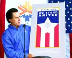 FILE - In this Sept. 17, 2001, file photo, shows Mitt Romney, president of the Salt Lake Organizing Committee, with the new Olympic