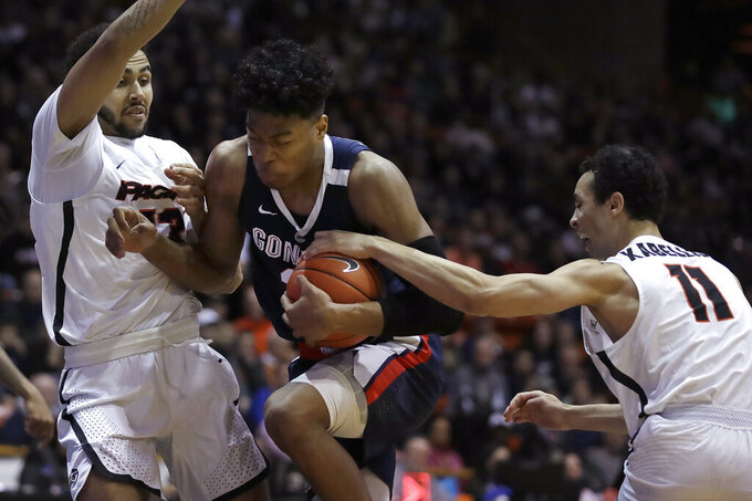 Gonzaga's Rui Hachimura, center, drives the ball between Pacific's Jeremiah Bailey, left, and Khy Kabellis during the first half of an NCAA college basketball game Thursday, Feb. 28, 2019, in Stockton, Calif. (AP Photo/Ben Margot)