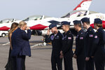 President Donald Trump, accompanied by first lady Melania Trump, greets members of the U.S. Air Force Thunderbirds at Daytona Beach International Airport, Sunday, Feb. 16, 2020, in Daytona Beach, Fla. Trump was at the NASCAR Daytona 500 auto race at Daytona International Speedway. (AP Photo/Alex Brandon)