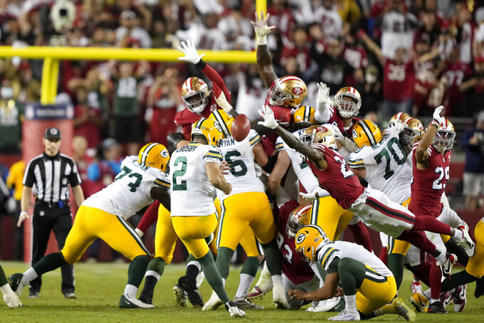 Green Bay Packers kicker Mason Crosby (2) kicks the game winning field goal from the hold of Corey Bojorquez during the second half of an NFL football game against the San Francisco 49ers in Santa Clara, Calif., Sunday, Sept. 26, 2021. (AP Photo/Tony Avelar)