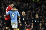 Manchester United's Harry Maguire, left, and Manchester City's Gabriel Jesus react at the end of the English Premier League soccer match between Manchester City and Manchester United at Etihad stadium in Manchester, England, Saturday, Dec. 7, 2019. (AP Photo/Rui Vieira)