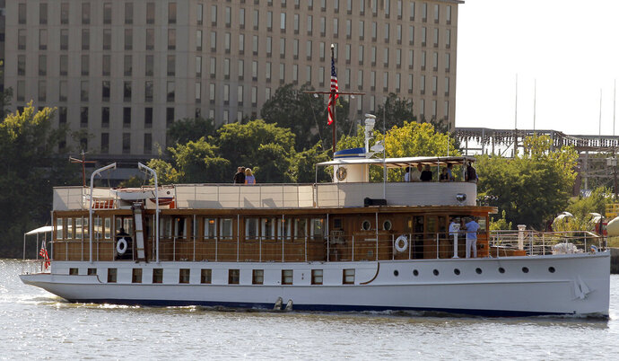FILE - In this Sept. 6, 2013 file photo, the yacht Sequoia motors on the Anacostia River in Washington. WABI-TV reports the boat that was once a yacht for American presidents is scheduled to dock in Belfast, Maine on Monday, Oct. 21, 2019.  The vessel will arrive on top of a barge since it is not currently seaworthy. It will be restored at French & Webb over the next several years. (AP Photo/Alex Brandon, File)