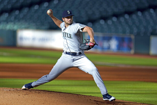FILE - In this July 27, 2020, file photo, Seattle Mariners starting pitcher Kendall Graveman throws to a Houston Astros batter during the first inning of a baseball game in Houston. Graveman and the Mariners agreed to a $1.25 million one-year contract Thursday, Oct. 29, after the team declined his $3.5 million option in favor of a $500,000 buyout. Graveman agreed last year to a $2 million deal that included a $1.5 million salary for 2020 plus the option year. He earned $555,556 in prorated pay. (AP Photo/David J. Phillip, File)