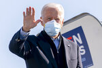 Democratic presidential candidate former Vice President Joe Biden boards his campaign plane at New Castle Airport in New Castle, Del., Saturday, Oct. 31, 2020, to travel to Flint, Mich. to campaign with former President Barack Obama. (AP Photo/Andrew Harnik)